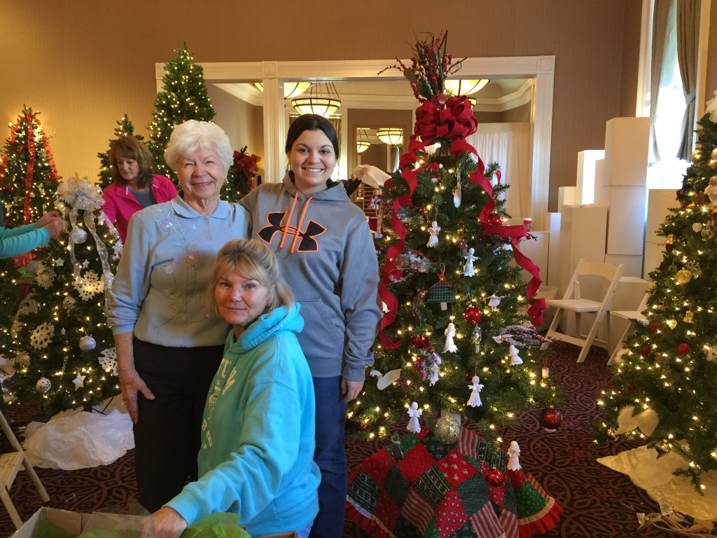 "Londonderry on the Tred Avon residents and staff decorated a tree, ""Sweet Memories of Our Wonderful Lives,"" for the 2015 Festival of Trees in Easton, MD. Pictured left to right are Londonderry resident Dottie Dew; Kathy Hill, Londonderry Sales and Marketing Assistant, who led the Londonderry decorating group; and Kirsten Mullins Londonderry Dining Room Supervisor. Other participants in the project, but not pictured, are Londonderry residents Thelma Haney, Pat Lewers, Natalie Caccia, Lari Caldwell, Gail Woodall, Clare Kettell, and Barbara Hargroves."