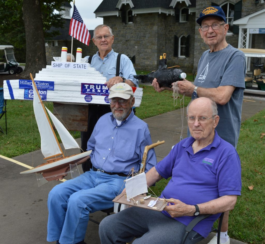 "Pictured back row, left to right are Londonderry 2016 Regatta winners: Ken Sadler for the ""Most Humorous"" for Ship of State; Art Schmidt for the ""Most Creative"" for the USS Nautilus; Ed Schmidt for ""Most Elaborate"" for USS Londonderry; and Jim Bradley for the ""Best Craft of All Natural Elements"" for Adventures of Tom Sawyer."
